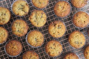 cupcakes on a cooling rack with chocolate chips and banana